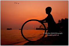 A dream for a new sunrise.     (Ehtesham Khaled [www.ehteshamkhaled.com]) Tags: camera boy sunset sea bw cloud sun white black bird art water river lens island nikon media ray walk smoke horizon wave fair bamboo fairy step pip jar dhaka khaled ehtesham bangladesh silhoutte bangla advertise bangali banga megh  kolosh maowa  sham619 mawoa talelittle   gettyimagesbangladeshq3 gettyimagesbangladeshq12012