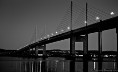 Kessock at Night (Reworked) (OnlyDanBrown) Tags: bridge sea bw white black water lines reflections river concrete lights scotland highlands suspension geometry cables huge inverness firth kessock