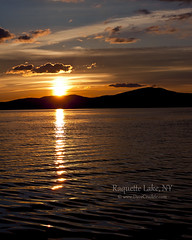 Raq (Zero Sequence) Tags: park new york sunset lake ny mountains color water clouds glare state dusk adirondack raquette