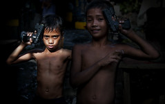 Little Soldiers who could be killed but would never die (Mio Cade) Tags: boy game children soldier kid fight war cambodia gun kill die pistol violence phnom penh