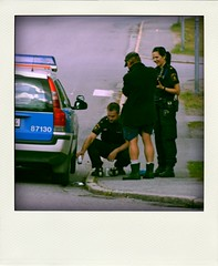 Police pour booze down the drain... (Steffe) Tags: summer beer caf drunk sweden police haninge handen confiscated poladroid swedishlawofthedayfrargelsevckandebeteende