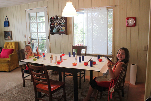 girls making patriotic craft at dining room table