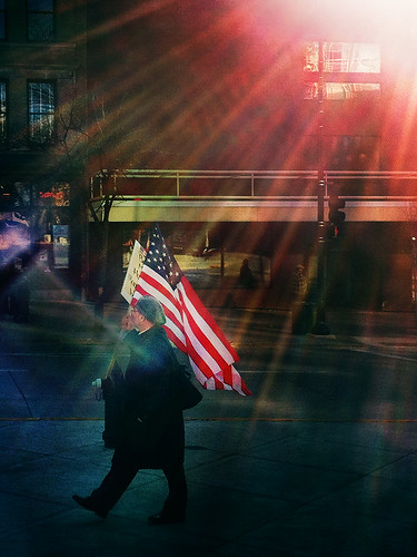 Setting Sun Spotlights Solitary Protester's Flag