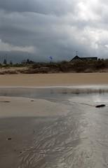 14-4-2011 (Copperhobnob) Tags: sky shells seaweed rock clouds sand saltire stcombsbeach