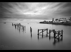 All that remains..... (Chrisconphoto) Tags: longexposure sky bw canon eos movement mood drama swanage remains chrisconway ndfilter oldpier 2minutes weldingglass 400d wwwchrisconphotocom