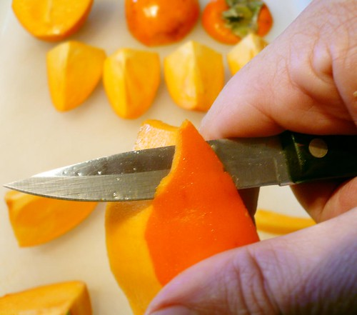 Cutting up persimmons