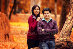 A happy couple... {Explored} {Front Page} (whoisnd) Tags: portrait people india tree fall colors canon happy sweater couple branch smiles vivid happiness foliage explore jeans trunk frontpage 70200 pullover chandigarh 70200mm vividcolors explored 1d4 chattbir 1div