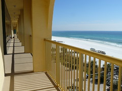 (perpetually dishevelled) Tags: ocean beach yellow hotel coast view florida balcony arches courtyard shore railing whitesand