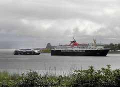 Calmac and cruise boat