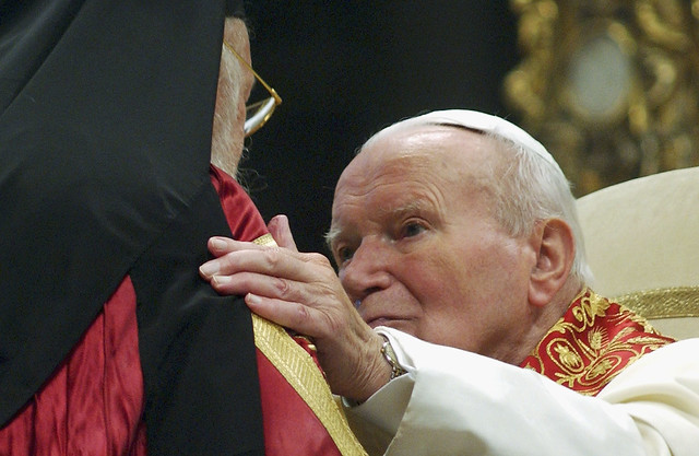 Pope John Paul II Embraces Greek Orthodox Patriarch