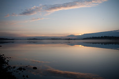 sunrise reflection (Henrik Kalliomäki) Tags: morning blue sea sky cloud sun reflection water stone night sunrise finland helsinki vanhankaupunginlahti clear arabia canoneos400d
