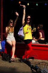 """Hello!"" (Chris JL) Tags: hello uk ladies london window sunglasses bar photo candid sunday smiles streetphotography lightbulbs shoreditch mojito cocktails redwall bricklane e2c redtights yellowtop spnp clashingcolors nikkor2470mmf28g chrisjl handwaves"