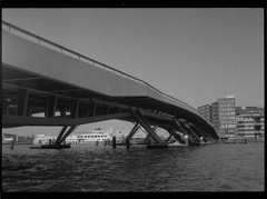 amsterdam architecture seen from the water (douweplukkel) Tags: blackandwhite bw film water amsterdam architecture analog boat sailing canals analogue ilforddelta400 olympuspenee3 ij janschaeferbrug hetij olympuspenee mimoa ee3 ilforddelta amalocoam74 amaloco stadsarchiefamsterdam amsterdamstadsarchief theij
