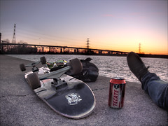 Glow (Gn!pGnop) Tags: bridge blue sunset orange ontario canada broken beer burlington relax landscape concrete pier waves glow purple horizon wheels lifestyle calm nike carve tecate shore longboard backpack skateboard trucks puma lakeontario embrace chill liftbridge oneman roughwater onpowerlines brownpop