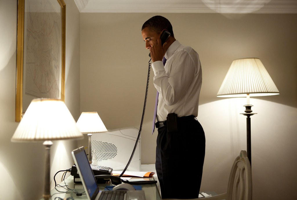 President Obama talks to Missouri Governor Jay Nixon on the phone.