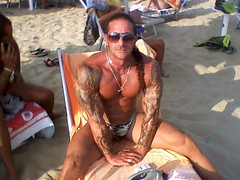 tatto muscle (balticaud) Tags: bear hairy man hot sexy male guy beach jock tattoo nude underwear body muscle tan hunk thong camouflage speedo package stud swimwear tanned bulge