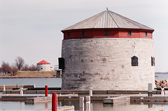 Three towers - Kingston, Ontario (Richard Wintle) Tags: ontario canada film 35mm iso200 fuji asahi pentax harbour kingston m42 spotmatic 135 fortification f28 confederationpark 135mm martellotower shoaltower spotmaticf easypix cans2s cathcarttower bushness fortfredericktower