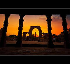 Sunset, Qutub (sushil.kumaar) Tags: old blue sunset sky people cloud building tree men brick bird grass stone garden photography evening stem women photographer branches delhi dry structure dilli qutub built emperor qutubminar redstone mughal sushil iltutmish qutubuddin sushilkumar sushilkumarphotography wwwsushilkumarin