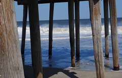 Under the Boardwalk (Brittnee Rae) Tags: ocean sea beach water pier sand waves boardwalk piling crashing