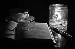 candlelight scene b&w (loco's photos) Tags: blackandwhite bw white black cup night 50mm glasses book candle pentax tea flame 17 candlelight kr pentaxa50mmf17 pentaxa5017 pentaxkr