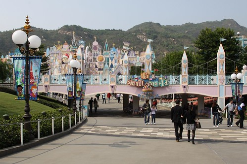 Entrance to It's a Small World, the Disneyland Railroad crosses the bridge in the foreground