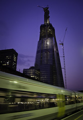 The Shard in Progress (Sven Loach) Tags: uk england urban blur colour building london station architecture modern speed skyscraper train canon londonbridge lights evening early movement cityscape britain crane platform frame inprogress publictransport underconstruction shard tfl g12 londonist 2011