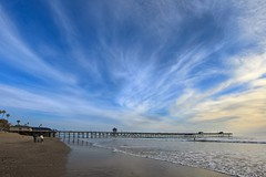 beach life (Eric 5D Mark III) Tags: ocean california family blue sunset sky people usa cloud seascape color beach water canon landscape pier unitedstates surfer horizon wave wideangle orangecounty sanclemente ef14mmf28liiusm eos5dmarkii
