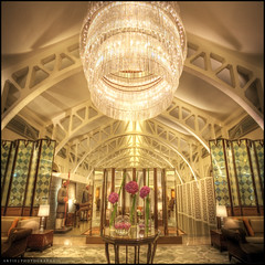 The Elegant Chandlier in the Fullerton Bay Hotel, Singapore :: HDR :: Vertorama (:: Artie | Photography ::) Tags: reflection building architecture modern photoshop canon hotel singapore shiny waterfront interior wideangle symmetry handheld elegant fullerton glittery ef 1740mm hdr highiso artie cs3 marinabay chandlier 3xp f4l photomatix tonemapping tonemap vertorama 5dmarkii 5dm2 fullertonbay