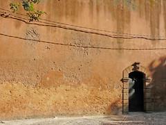la petite porte (Sola) Tags: door shadow wall ombre morocco lane maroc medina porte ruelle ochre mdina oudayas flickrunitedaward