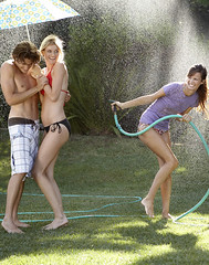 Teens Playing in the Summer (MikeHenryPhoto) Tags: summer hot guy water girl grass weather kids umbrella fun losangeles backyard warm play spray hose teen health sprinkler laugh teenager squirt swimsuit bathingsuit mikehenry lifestylephotographer mikehenryphotocom