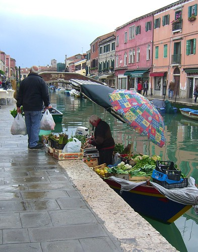 Grocer on a boat in Venice by Danalynn C