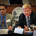 Microcell's Ray Eshraghi listens as Elster's Mark Munday (right) speaks.