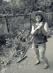 Vivian the apprentice gardener (NYCandre) Tags: nyc newyorkcity urban bw woman gardens modern garden traditional korean postprocess gardener 4006 greennyc 100strangers meltingpotindeed