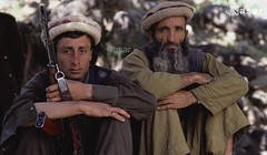 Afghan Mujahideen 1985 (Pashtun Afghan) Tags: 2 people afghanistan men portraits outdoors holding asia gun sitting asians military muslim rifle beards weapon males facialhair adults machinegun guerrilla afghans youngadults headandshouldersportraits assaultrifle ak47rifle mujahideen centralasians nuristanprovince nuristanis pakols