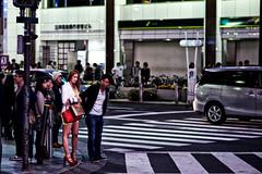boy meets girl. boy falls in love. girl doesn't. (sinkdd) Tags: street boy girl japan tokyo nikon shinjuku highheel 85mm heels  nikkor redshoes  d800 redheels pickingup trafficcrossing streetsnap nikond800 f18g sinkdd afsnikkor85mmf18g