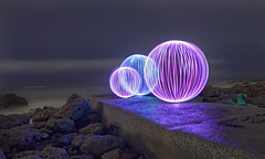 3 orb jetty (Mike Ridley.) Tags: uk longexposure pink blue sea england cold colour rock canon ball photography coast rocks raw waves jetty shoreline orb led moonlit coastal paintingwithlight coastline disused nightscene orbs northeast illuminate seaham pitchblack northeastcoast sooc canon50d chemicalbeach canonefs1755mm28isusm fellwalker1