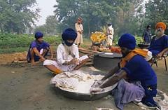Mobile Encampment (gurbir singh brar) Tags: camp cooking outdoor sikhs punjab campsite nikonf6 chappati nihangs parshada gurbirsinghbrar chaldavaheer mobileencampment