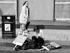 _DSC0001 (3) (fatty-arbuckle) Tags: girls blackandwhite bw shoes sitting legs cityhall protest streetphotography belfast bin placards nireland texting royalavenue educationcuts
