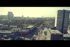 Chrisp Street Market - East London (Luke_Williams) Tags: from above old city blue light summer sky london tower vintage buildings photography looking estate williams angle hometown luke style down panoramic blocks distance cinematic stratford 2012