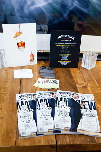Table full of Appleton Reserve, Esquire magazine, and both restaurants' info