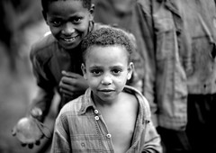 Benje tribe kids - Ethiopia (Eric Lafforgue) Tags: africa people blackandwhite girl smile childhood smiling horizontal youth outside outdoors person kid child noiretblanc joy jeunesse innocence ethiopia enfant fille sourire bonheur naivete personne humanbeing joie hapiness contemplation 0311 afrique dehors eastafrica enfance abyssinia ethiopie sourir exterieur lookingatcamera blackandwhitepicture waistup abyssinie vueexterieure afriquedelest alataille etrehumain photoennoiretblanc regardantlobjectif cadragealataille