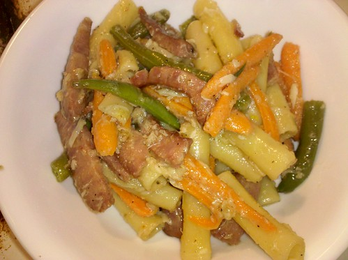 Pasta with sausage, carrots, and green beans tossed in a bagna cauda