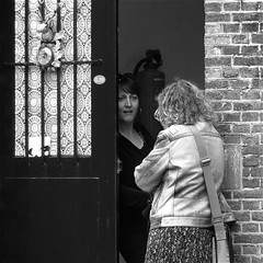 .....AT THE DOOR (Akbar Simonse) Tags: street door people bw netherlands women zwartwit candid streetphotography prison jail conversation talking deur leeuwarden streetshot straat ljouwert straatfotografie straatfoto blokhuispoort akbarsimonse strafgevangenis