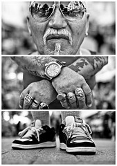Triptychs of Strangers #14: The Grieving Sailor - Schanze, Hamburg (adde adesokan) Tags: street travel portrait blackandwhite bw white black sunglasses tattoo pen beard photography shoes triptych bokeh buttons voigtlander voigtlaender hamburg bart streetphotography tire olympus stranger portrt tattoos rings sw mann brille schwarzweiss brcke stpauli weiss schuhe schwarz voigtlnder sonnen