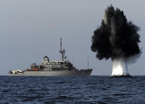 A demolition charge detonates 1,500 meters from the Avenger-class mine countermeasures ship USS Scout (MCM 8).