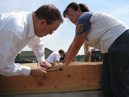 Agriculture Under Secretary for Rural Development Dallas Tonsager helps prospective homeowner Suzanne Passwaters construct floor joists at a USDA Self Help Housing site on the DelMarVa Peninsula.