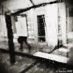Rainy Day (ylfaure) Tags: street blackandwhite bw france water monochrome rain square calle drops lluvia agua eau mood noiretblanc pluie atmosphere nb squareformat raindrops fv10 rue reims  regen carr  throughtheglass       yamur   50fav 50faves   ma    yoanloicfaure ylfaure    yoanlocfaure