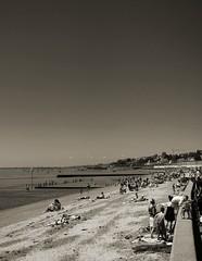 Chalkwell Beach (trisgti) Tags: uk greatbritain family sea england sky bw beach monochrome thames canon river blackwhite sand unitedkingdom horizon crowd powershot bikini gb grayscale groyne essex leighonsea chalkwell s95