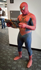 Spiderman Reading (uncle_shoggoth) Tags: sanfrancisco costume san francisco comic cosplay spiderman convention comiccon con wondercon
