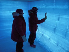Dr. Julie Palais (left), NSF-OPP Glaciology Program Manager, and Anais Orsi (right) inside a back-lit snow pit at WAIS Divide